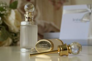 Engrave your name and wedding date on the bottom of the vintage perfume bottle.